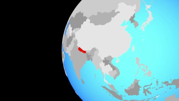 Nepal on blue political globe. Orbiting around globe and zooming to the country. 3D illustration.