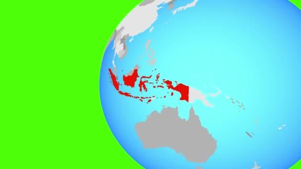 Indonésie na modré politické globe. Obíhající kolem zeměkoule a přiblížení k zemi. 3D obrázek