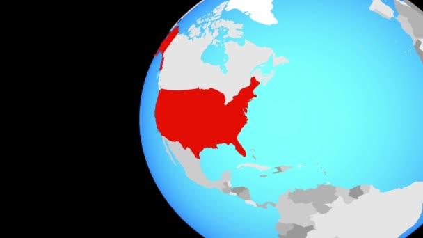 Spojené státy na modré politické globe. Obíhající kolem zeměkoule a přiblížení k zemi. 3D obrázek