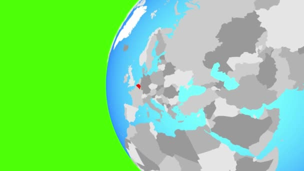 Belgium on blue political globe. Orbiting around globe and zooming to the country. 3D illustration.