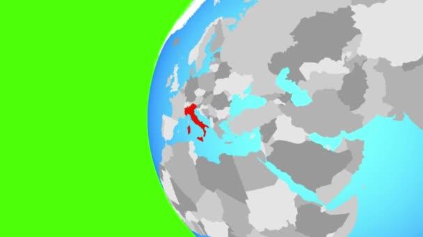 Itálie na modré politické globe. Obíhající kolem zeměkoule a přiblížení k zemi. 3D obrázek