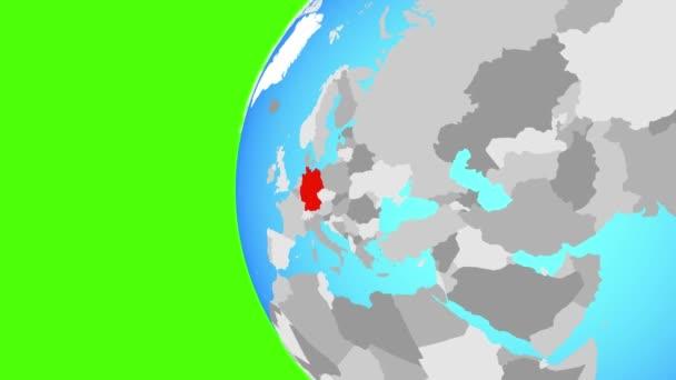 Německo na modré politické globe. Obíhající kolem zeměkoule a přiblížení k zemi. 3D obrázek.