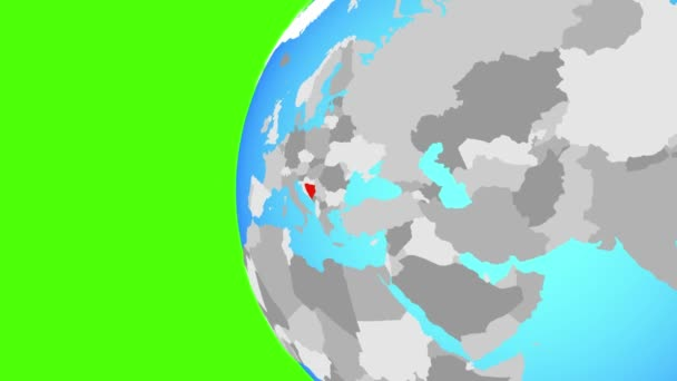 Bosnia and Herzegovina on blue political globe. Orbiting around globe and zooming to the country. 3D illustration.