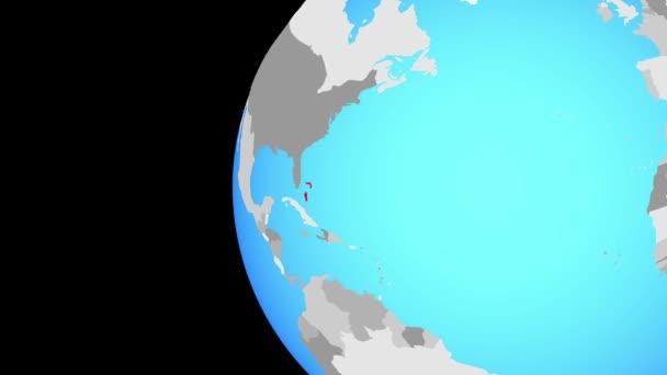 Bahamy na modré politické globe. Obíhající kolem zeměkoule a přiblížení k zemi. 3D obrázek.