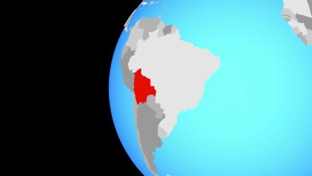 Bolívie na modré politické globe. Obíhající kolem zeměkoule a přiblížení k zemi. 3D obrázek