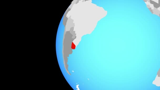 Uruguay on blue political globe. Orbiting around globe and zooming to the country. 3D illustration.