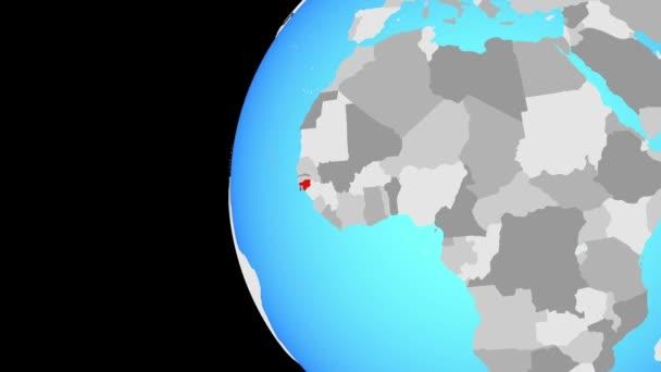 Guinea-Bissau o modré politické zeměkoule. Obíhající kolem zeměkoule a přiblížení k zemi. 3D obrázek