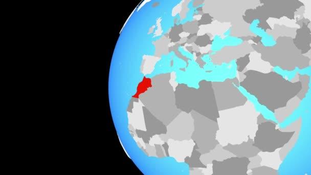 Maroko na modré politické globe. Obíhající kolem zeměkoule a přiblížení k zemi. 3D obrázek