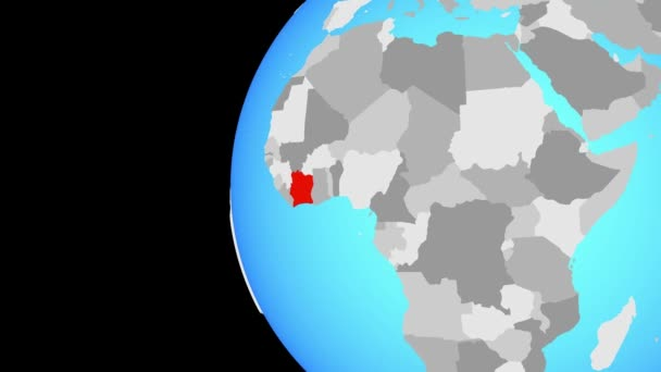Ivory Coast on blue political globe. Orbiting around globe and zooming to the country. 3D illustration.