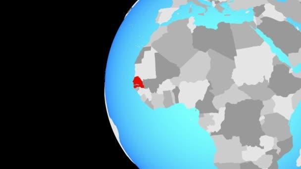 Senegal na modré politické globe. Obíhající kolem zeměkoule a přiblížení k zemi. 3D obrázek