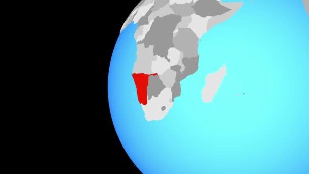 Namibie na modré politické globe. Obíhající kolem zeměkoule a přiblížení k zemi. 3D obrázek