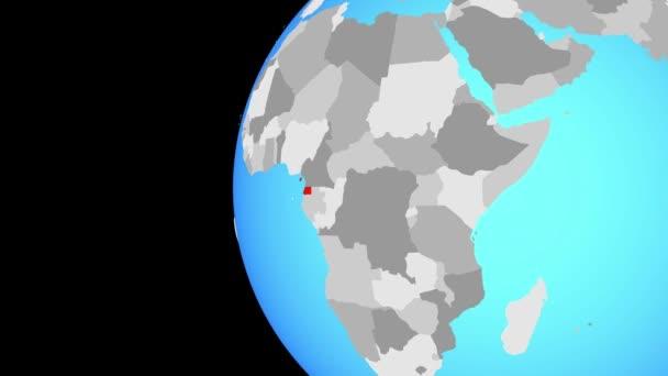 Rovníková Guinea na modré politické globe. Obíhající kolem zeměkoule a přiblížení k zemi. 3D obrázek
