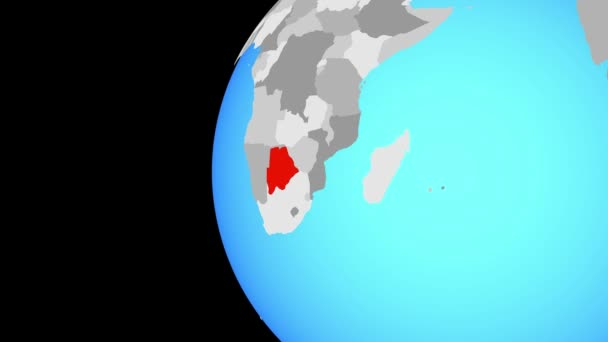 Botswana on blue political globe. Orbiting around globe and zooming to the country. 3D illustration.