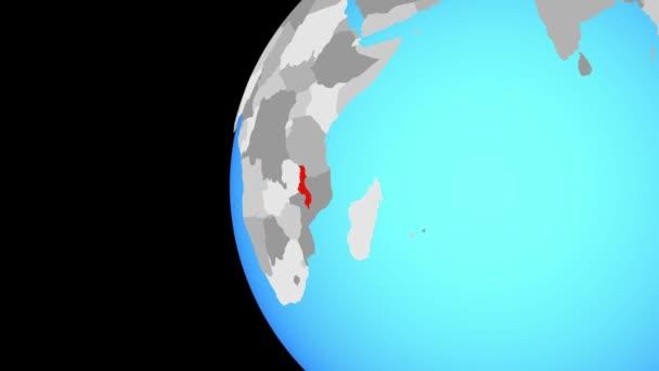 Malawi na modré politické globe. Obíhající kolem zeměkoule a přiblížení k zemi. 3D obrázek