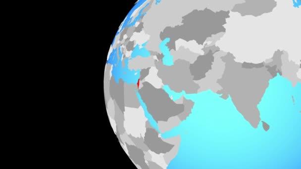 Izrael na modré politické globe. Obíhající kolem zeměkoule a přiblížení k zemi. 3D obrázek