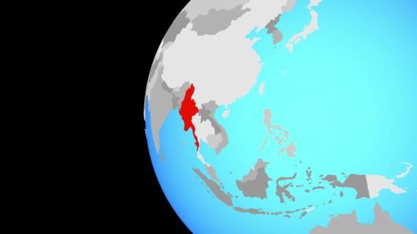 Myanmaru na modré politické globe. Obíhající kolem zeměkoule a přiblížení k zemi. 3D obrázek