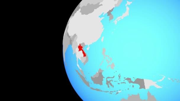 Laos auf blauen politischen Welt. Globus umkreisen und Zoomen auf dem Land. 3D illustration.