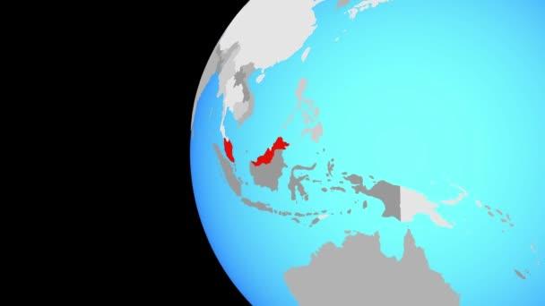 Malaysia am blauen politischen Welt. Globus umkreisen und Zoomen auf dem Land. 3D illustration.