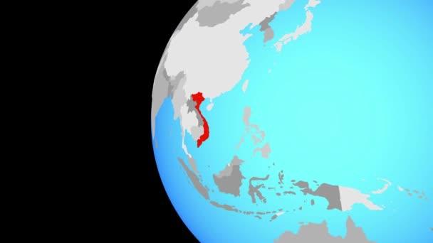 Vietnam na modré politické globe. Obíhající kolem zeměkoule a přiblížení k zemi. 3D obrázek