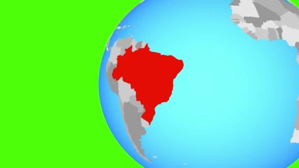 Brazílie na modré politické globe. Obíhající kolem zeměkoule a přiblížení k zemi. 3D obrázek