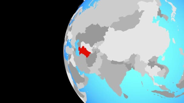 Turkmenistán na modré politické globe. Obíhající kolem zeměkoule a přiblížení k zemi. 3D obrázek