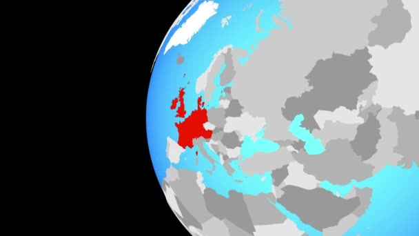 Western Europe on blue political globe. Orbiting around globe and zooming to the country. 3D illustration.