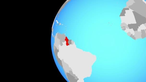 Guyana na modré politické globe. Obíhající kolem zeměkoule a přiblížení k zemi. 3D obrázek