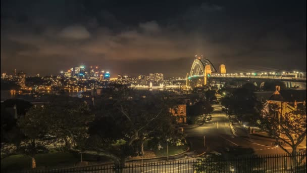 Timelapse of the spectacular Sydney Harbour Bridge at night with the illuminated cityscape of Sydney.