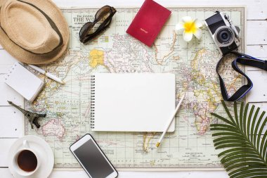 Flat lay view of travel vacation planing table top shot with related objects still life. Text space image.