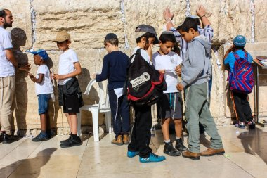 Jerusalem Israel May 14, 2018 Unknowns people and kids praying front the Western wall in the old city of Jerusalem in the evening