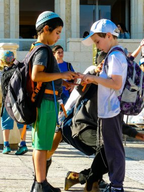 Jerusalem Israel May 14, 2018 unknown kids in front of the public fountain on the Western Wall Square in Jerusalem