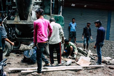 Kathmandu Nepal August 24, 2018 View of unknowns Nepali worker building a new house in Durbar street in Kathmandu in the morning