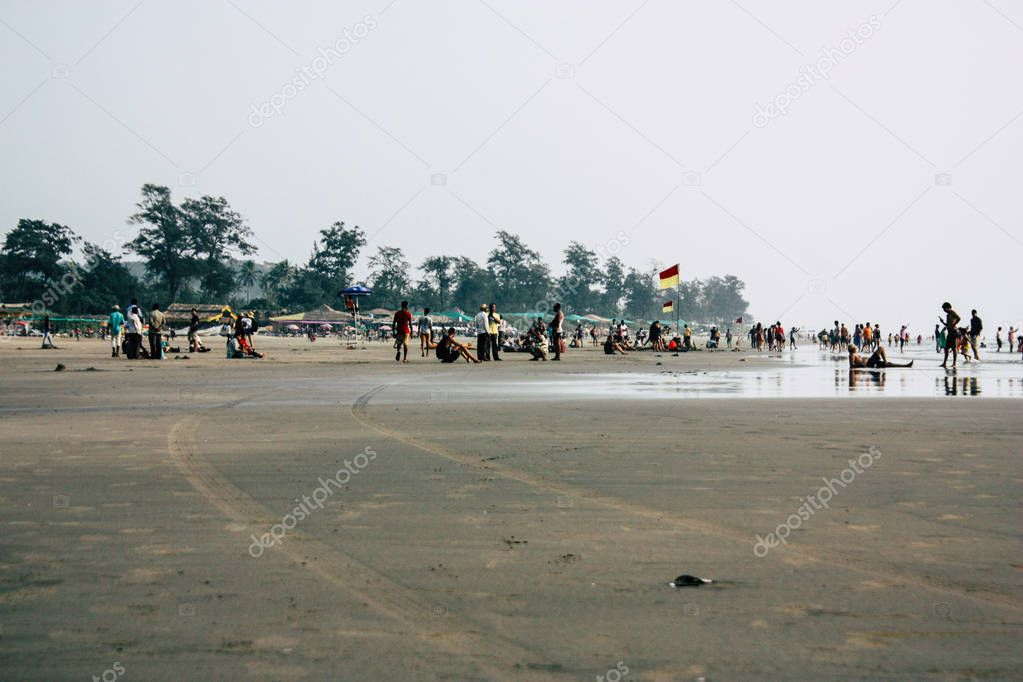 Arambol Goa India November 24, 2018 View of unknowns tourists visiting Goa and walking on the beach of Arambol in the afternoon