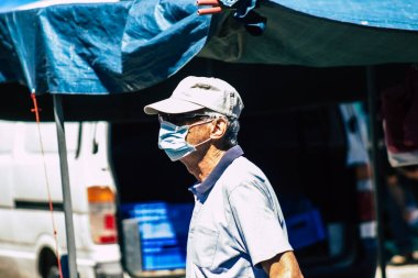 Limassol Cyprus June 13, 2020 Portrait of unidentified people with a face mask to protect themselves from the coronavirus shopping at the Limassol market in the morning