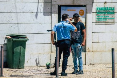 Lisbon Portugal August 04, 2020 View of police officer in the streets of Lisbon, the hilly coastal capital city of Portugal and one of the stunning oldest cities in Europe