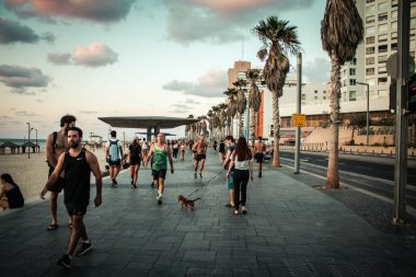 Tel Aviv Israel October 04, 2020 View of unidentified people without a face mask to protect themself walking on Herbert Samuel Promenade in Tel Aviv during lockdown and Coronavirus outbreak