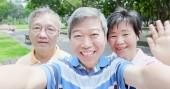 Fotografie old people  taking selfie happily in the park
