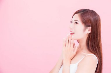 beauty skincare woman smiling  happily on the pink background