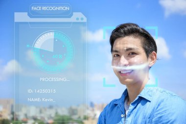 Asian young man using the concept of face recognition.