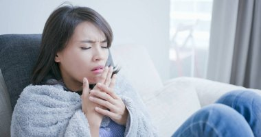 sick woman get a cold and cough at home