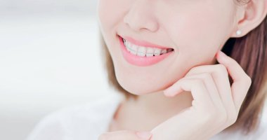 Close up of Beauty woman wear retainer for teeth and smile to you