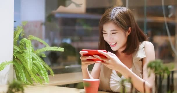 Young woman play mobile game ⬇ Video by © ryanking999 Stock Footage  #255436332