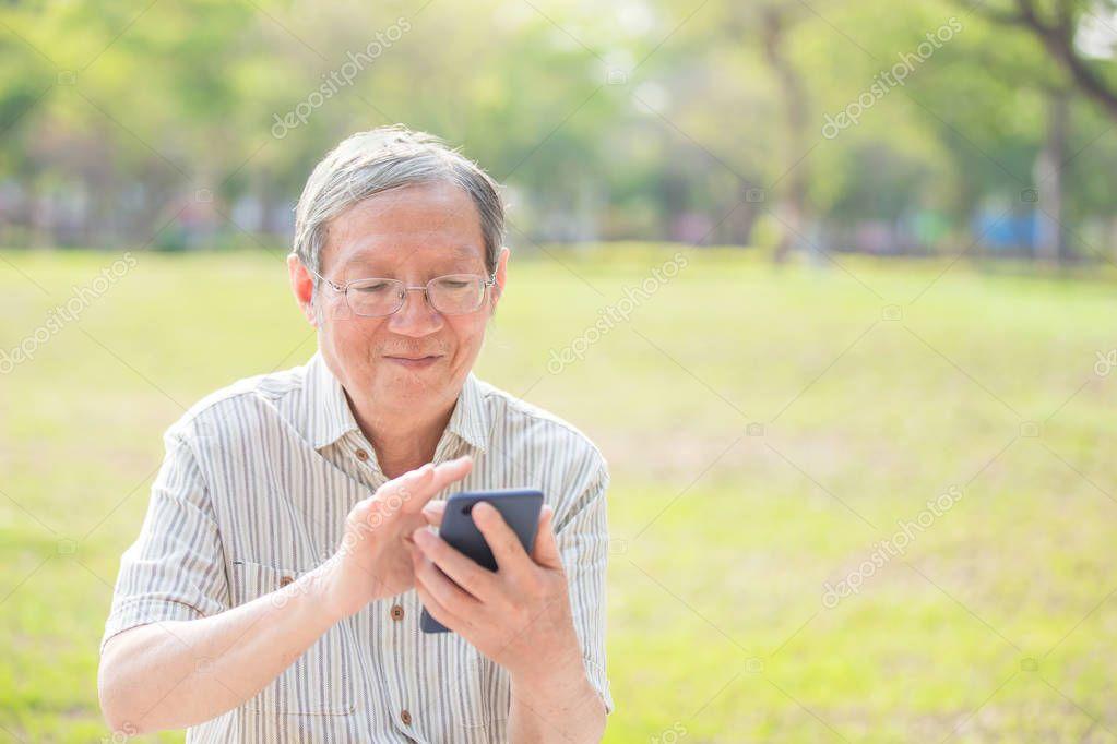 Older man use cellphone