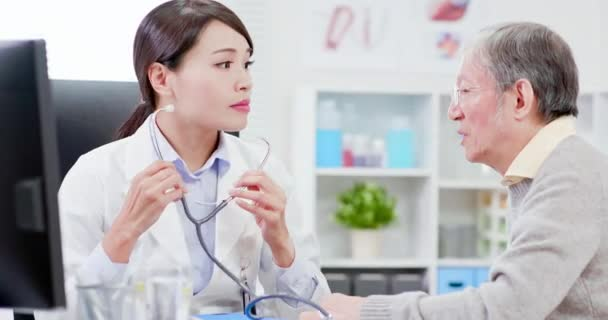 Female doctor do heartbeat check