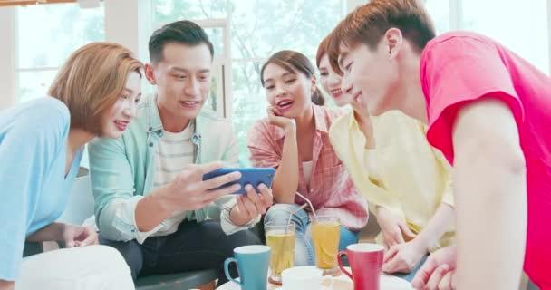 friends watch video on phone