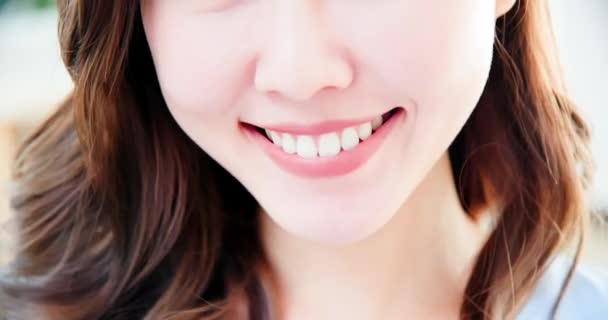 asian woman has toothy smile