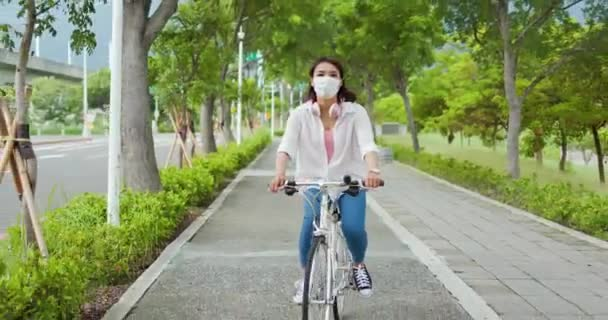 Asian female ride bicycle