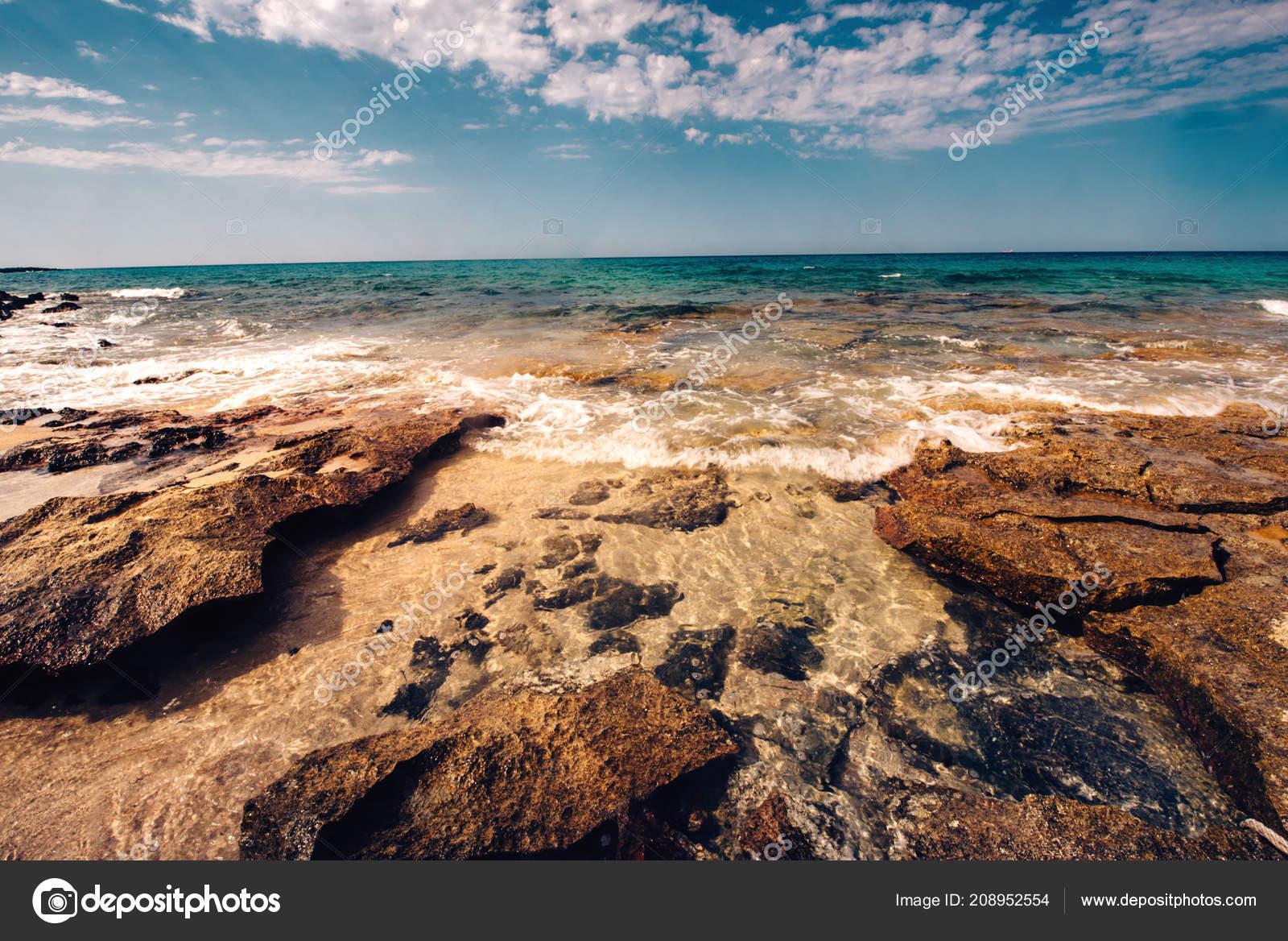 View Beautiful Beach Weaves Hitting Rocks Scenic Wallpaper