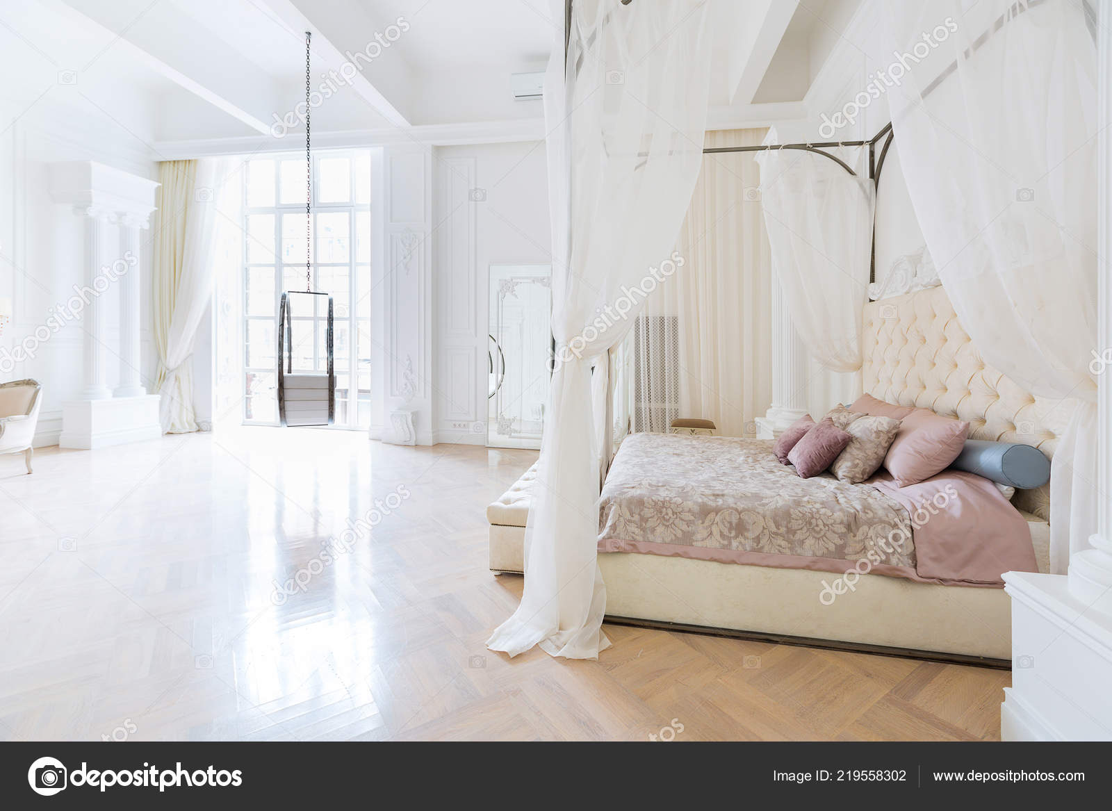 Luxury rich bedroom interior design elegant classic furniture swing shape stock photo