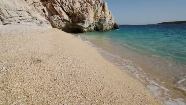 Beautiful mediterranean sea coastline, strong waves crashing in slow motion on seashore with foam on yellow clean sand